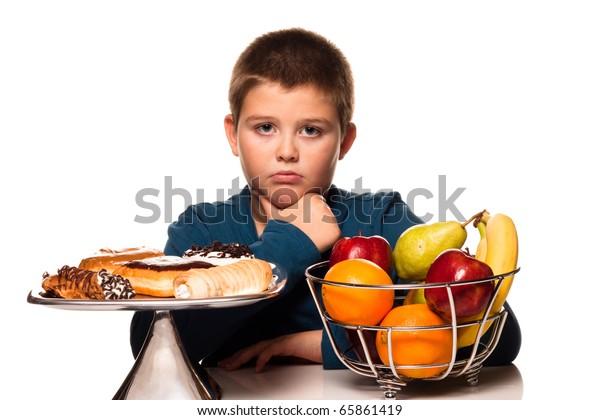 a boy's choice of a healthy or unhealth snack