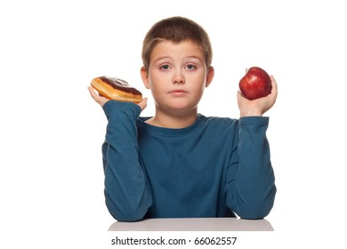 a boy's choice of a healthy or unhealthy snack - donut or apple