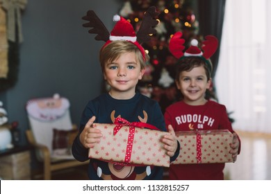 Boys with Christmas gifts
