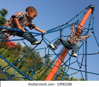 Boys Climbing Ropes
