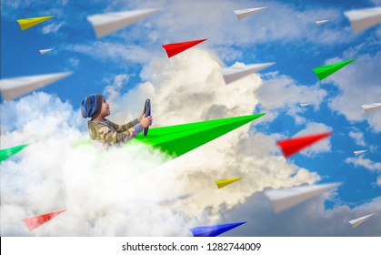 Boys enjoy driving paper airplanes soaring up in the sky filled with many paper planes, concepts, vision and leadership to lead the organization to success.