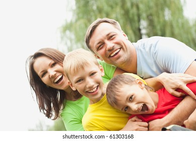 boys with family in the summer park