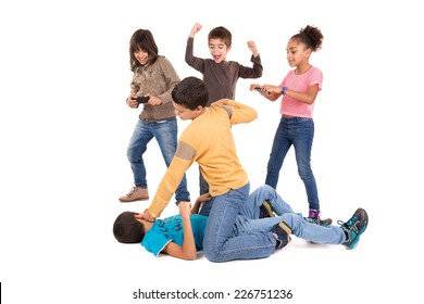 Boys fighting with other kids cheering and filming
