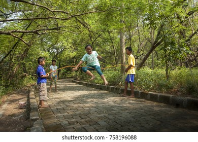 Boys and Girls Playing Traditional Games in Jakarta's City Forest Indonesia. 23 September 2017