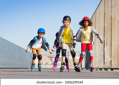 Boys and girls rollerblading at stadium outdoors