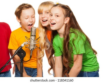 Boys and girls singing in microphone