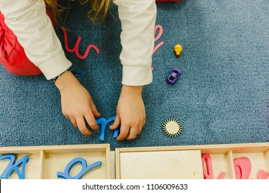 Boys and girls students in a montessori school manipulating their material to learn , hands