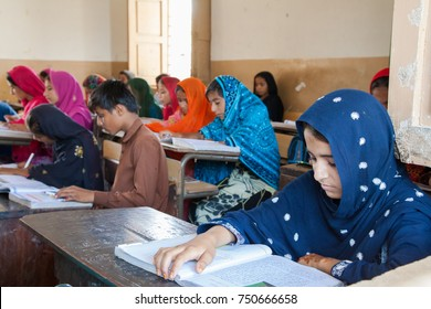 Boys and Girls Studying in a classroom together. Thatta, Sindh, Pakistan - September 08 2015. Government Schools Condition.