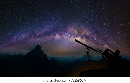 Boys and girls telescopic. Milky Way galaxy, on high mountain Long exposure photograph, with grain.Image contain certain grain or noise and soft focus.