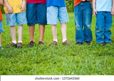 Boys with Grass-Stained Pants Standing Together Outside