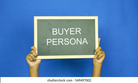 "boys hand holding a blackboard with the words "" BUYER PERSONA"""