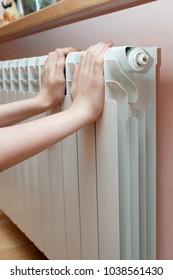 Boy's hand on the warm heater