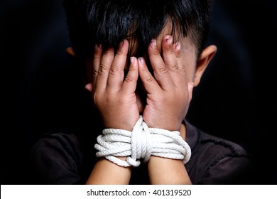 Boy's hands were tied with a rope, child abuse.