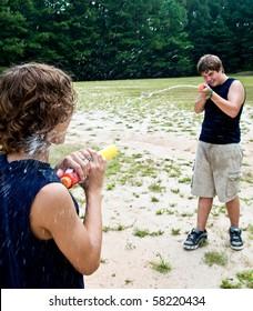 boys having water gun fight