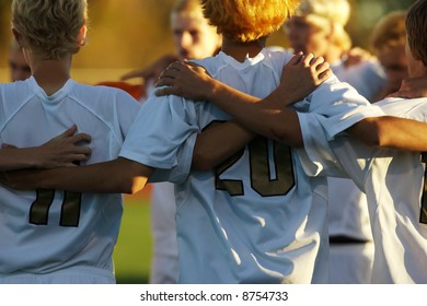 Boys high school soccer huddle