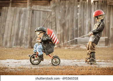 Boys in the image of a rider and a rocket-man play in the backyard of the house