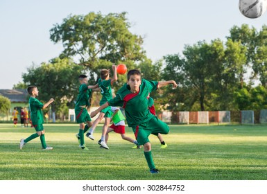 Boys kicking ball at goal