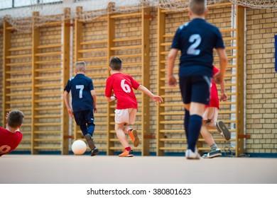 Boys kicking ball at goal
