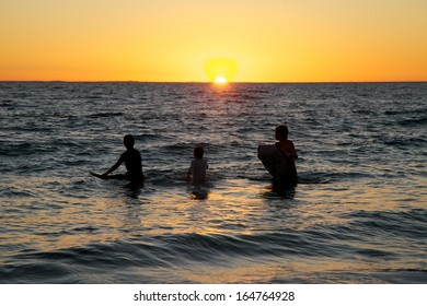Boys on Boards in Sunset