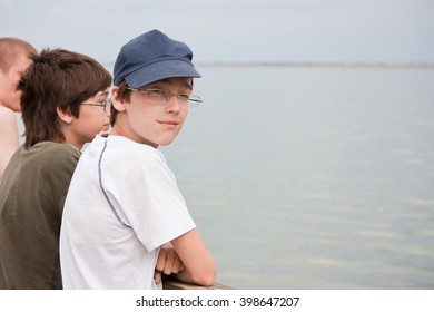 the boys on the deck of the ship looking at the water
