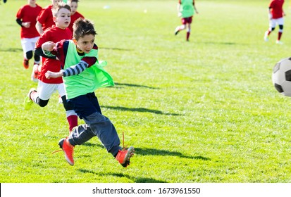 Boys play soccer on the field