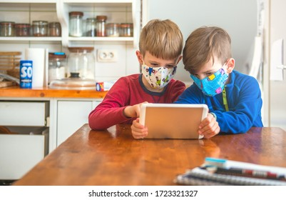 Boys Playing With Digital Tablet And Wearing Protective Face Mask