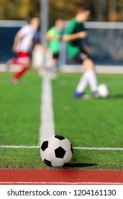 Boys playing a football match and empty space for text