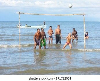 Boys playing football on the coast of Livingston in Guatemala, 18 February 2014