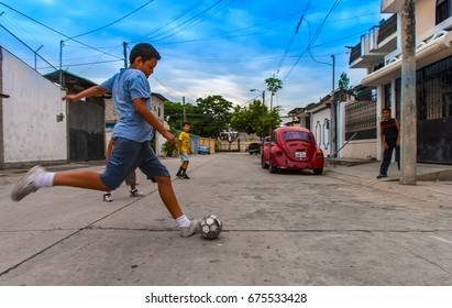 Boys playing football in the street. Guayaquil, Ecuador. 01. 05. 2006