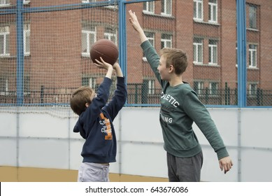 Boys playing on the basketball court