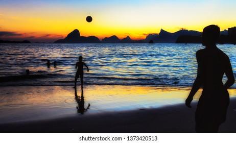 Boys Playing with a Soccer Ball on Icaraí Beach Overlooking Rio de Janeiro