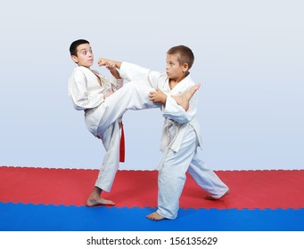 Boys with a red and white belt do paired exercises  karate
