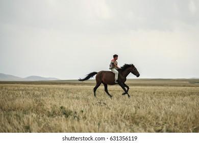 Boys are  Riding  Horses in a Beautiful Lowland-Kars,Turkey 14-10-2009
