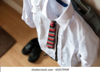 Boys school uniform on hanger
