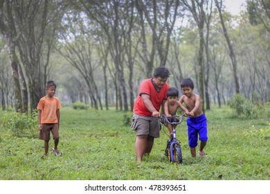 Boys selling traditional cakes in a Rubber Plantation Forest in South of Jakarta Indonesia. Date taken 29 April 2012