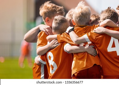 Boys Soccer Football Team Huddle. Children Play Sports Game. Kids Sporty Team United Ready to Play Game. Youth Sports For Children. Boys in Sports Jersey Orange Shirts. Young Boys in Soccer Sportswear