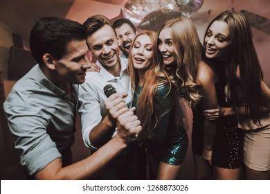 Boys Solo. Great Mood. Young People. Dance Club. Sing. Microphone. Trendy Modern Nightclub. Party Maker. Birthday. Karaoke Club. Celebration. Handsome Men. Beautiful Girls. Dancing People.