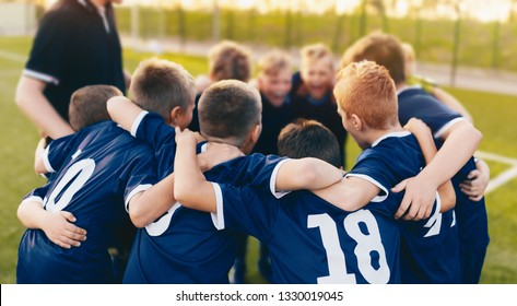 Boys Sport Team Huddle. Kids of Soccer Team Gathered Before the Tournament Final Match. Coach and Young Football Players Huddling. Sports Competition for Children