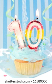 boy's tenth birthday cupcake with blue frosting and  decorative background