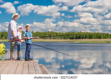 The boys and their father spend a day on a fishing trip on a sunny day