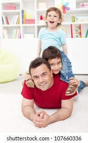 Boys time together - father and his two sons playing