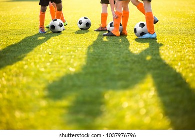 Boys Training Football on the Pitch. Soccer Football Training Session for Kids. Soccer Pitch on a Sunny Day. Soccer Skills Training. Football Stadium Grass Background