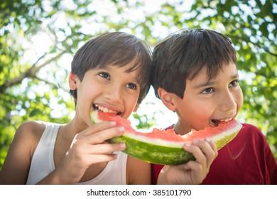 Boys with watermelon enjoying summer