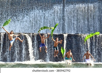 Boys were having fun by playing water in an artificial dam on the Tukad Unda dam, Bali, Indonesia. Bali island is a popular tourist destination in the world. Happiness, joyfull, friendship concep