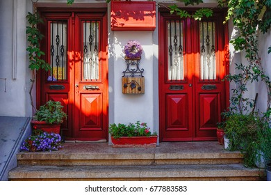 BOZCAADA, TURKEY - 4 JULY 2017: Vintage red doors with flowers.