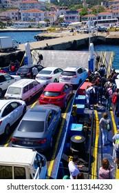 BOZCAADA, TURKEY - APR 28, 2018 - Ferry in Dardanelles approaching the island of Bozcaada, Turkey