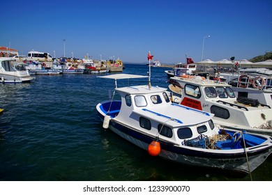 BOZCAADA, TURKEY - APR 28, 2018 - Fishing boats in the marina harbor of on the island of Bozcaada, Turkey