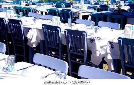 BOZCAADA, TURKEY - APR 28, 2018 - Blue restaurant on waterfront of  the island of Bozcaada, Turkey