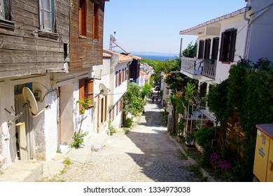 BOZCAADA, TURKEY - APR 28, 2018 - Small hotels in traditional konak style on the island of Bozcaada, Turkey
