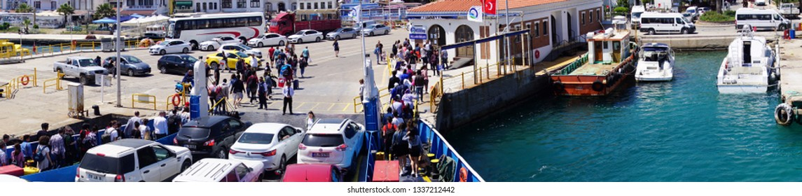 BOZCAADA, TURKEY - APR 28, 2018 - Passengers disembark the ferry on the island of Bozcaada, Turkey